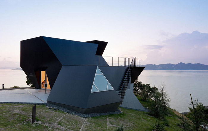 House by Ito sitting next to the water