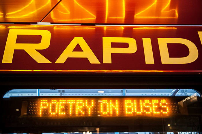 Close up of Rapid Ride bus screen with Poetry on Buses written on it